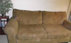 Olive green big comfy couch we are moving easy to carry cause it's not very heavy but awkward because it is very big