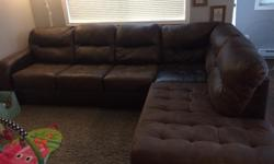 """Large brown sectional couch. Very big and comfy! Suede/faux leather material. 38"""" deep, 116"""" wide, 86"""" long (sectional side) Deep sinkable and comfy! Open to offers. Well taken care of non smoking home."""