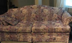 Enjoy movie nights with this big, sturdy, firm, comfy couch. It is in good shape. One cushion is tearing at a corner seam and could be easily repaired. Sits three, even four people easily.