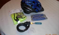 Garneau bike helmet rarely used. 54-61 cm. Comes with extra padding for helmet; day/night safety vest; bike lock.