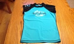 Turquoise blue Billabong top or bathing suit coverup. Size is medium. 80 % nylon and 20% spandex Like new Logo is on front, back and one sleeve