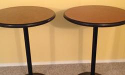 Two Bistro tables. Metal base and stand. Perfect for around a pool table or in a games room. Tables are 42 inches high. $100.00 for the pair.