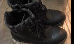 Size 1 black ankle boot with zipper and ties. Can also be used as a paddock boot for riding horses. Excellent condition.