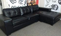 Black faux leather sectional for sale in excellent shape. Looking for quick sale and open to reasonable offers. Not open to trades. Call 250-415-0418 to view