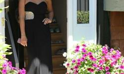 """Black grad dress for sale! Its in great condition. It was mine from last year and I loved it! It's a size 2 but message me for measurements because I normally wear a size 4 and I am 5'6"""" Tall and wore heals. $195 obo."""