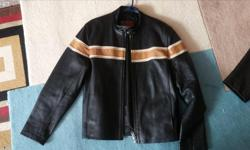 In excellent condition, hardly worn. Size Medium. Light brown and tan strip across chest, arms and back. Cell pocket.