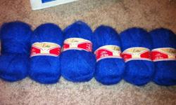 8 balls of blue yarn, 50g each. 60% acrylic, 20% wool and 20% nylon. One ball I played around with but did not use any of the yarn. $4 for the 8 balls. Flash makes it look brighter than it really is! This ad was posted with the Kijiji Classifieds app.