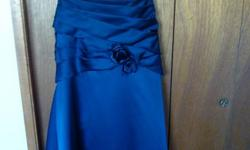 Strapless (comes with attachable straps) navy-royal blue grad dress with criss cross ties in the back Floor length for anyone around 5'8 (I'm 5'6 and wore inch and a half heels) Size 10 First picture depicts actual color