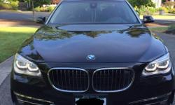 Make BMW Colour Black Trans Automatic kms 36500 2014 BMW 750Li xDrive, black color, executive package, technology and vision package, Rear comfort package, all top features include: heads-up display, massage seats, heated seats, ventilated seats, sunroof,