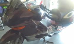 2001 BMW Motorcycle for sale with 76,797 km on engine, bike has all the bells and whistles, has windshield that moves up and down, has heated seat and handle bar grips, great stereo system, engine is water cooled great for touring, has 5spd trans. with