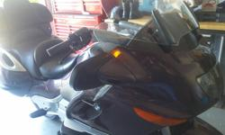2001 BMW 1200LT motorcycle for sale, good looking and great riding cruiser. The bike has a windsheild that moves up or down, has a heated seat and hand grips, has a good stereo with cassette player, cruise control, ABS brakes, engine is water cooled, it