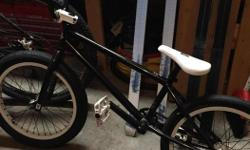 Selling my sons black Fit BMX bike. He never uses it. Bought new from spokes 2 years ago. Excellent condition but needs new wheel.