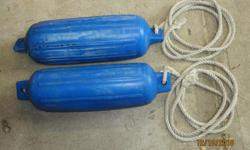 "Two boat / dock fenders 7"" X 21"" twin eye inflatables. c/w 10ft of cotton braided rope. 30.00 for both."