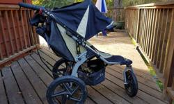 2010 BOB revolution with car seat adaptor, parent drink tray, snack tray (never used). Rain cover. Kept inside always, excellent shape. Not even faded. Compatible for certain carseats, manual included $275 firm located in Cobble Hill ** consider the