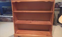 Solid pine bookcase, 35 inches wide by 36 inches high