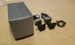 Bose speaker set including 2 speakers, subwoofer and volume/mute dial. Excellent condition.