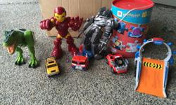 Big box of loved little boys toys including box of puzzles, remote control dinosaur, talking ironman, Optimus prime and more!!