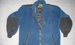 """Boy's 100% polyester fleece jacket """"WETSKINS"""" size XL (youth) machine washable. Navy blue with black on back of shoulders and back of sleeves (bottom half) zippered pockets with zippered pocket on upper left. Very good condition. Approx. size 14/16"""