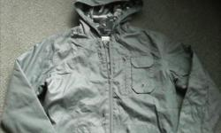 """Boy's """"GEORGE"""" grey, fleece lined, hooded jacket. 100% polyester shell with 100% polyester fleece lining. Approximate size 10-12 (S/P) Hood has grey camo net lining, side pockets and zippered pocket on left side, and 1 pocket on the inside of the jacket,"""
