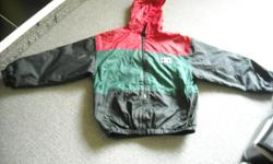 """Boy's nylon, fleece lined jacket, size 12. Black, green and red outer shell and black polyester fleece lining """"BADGE"""", elastic waist and cuffs. Zipper front, with hood and 2 front pockets. In good condition."""