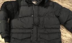 Boys navy blue winter coat from H&M age 8-9. Removable hood. Worn once - as new.