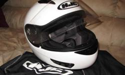 Selling a brand new HJC full-face helmet. Size is XS but it fit an adult lady, no problem. Not a scratch, not a mark, absolutely pristine. Has top vents and chin vents. Kept in the HJC cloth bag since I purchased it. Stored on a shelf in an immaculate,