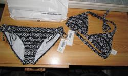 Hi, I am selling a brand new swimsuit. It has never been worn, tags are still attached. I bought it for a trip but never ended up going. The top is L, the bottom is XL. I am asking $70, I paid $88+ tax. Jessica
