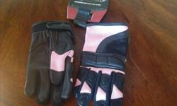 Brand new women's large motorcycle gloves. Ordered online but fit is too small. Never worn $30 firm