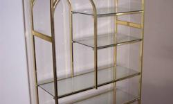 5 shelf brass and glass display unit for sale. 75 inches high x 38 inches wide x 16 inches deep. Very good condition. $75. Call Medicine Hat 403-487-1557.