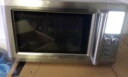 Like new Breville Microwave for sale. Comes with instruction manual. Does everything, is new and modern.