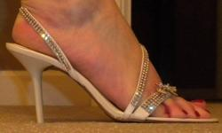 """Town Shoes beautiful off white with 3"""" heel and Swaroski crystal.  Worn once.  Bought for $140 selling for $50.  Size 8B.  Call 604.240.9310."""