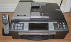 LIKE NEW!  All-in-one home or office color printer, scanner, fax machine, digital cordless phone and copier.  In perfect condition.  Complete with all original documents/manuals, cords, software.  Also complete with brand new black and color cartridges