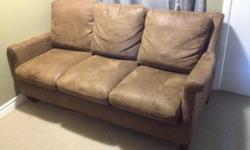 Brown faux leather couch. Removable cushions. Good condition.