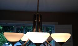 Remodelling and need to sell light fixture. Can be used in any room. Beautiful construction and clean lines. Purchased $500 Asking $125