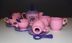 Fun Bubbles Tea Set - includes:  4 cups/saucers, 4 bubble wand spoons, teapot and cream & sugar containers.  The cups have an opening at the bottom, you put some bubbles mix in the saucer and use the cup to blow bubbles or use the spoons to dip into the