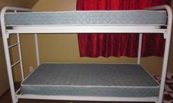 White metal bunk bed. Clean and in great condition. Mattresses included. Top safety rail not assembled or shown in photo, it is included with bunk bed purchase.