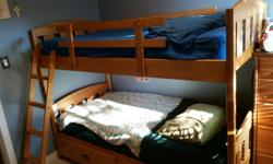 Twin-sized captain's bunk bed for sale. Bunkbed can come apart into two separate beds. Mattresses not included.
