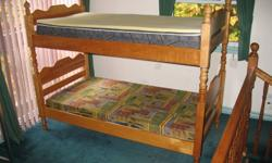 Very Sturdy Maple Bunk Beds With Mattresses. One Foam Mattress, One Coil Mattress with memory foam topper. Ladder (not Shown) and removable top rail (not Shown). Great Shape Very few marks. Can be used as two separate beds. $300.00 O.B.O.