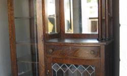 Im not sure of the age but i know it is at least fifty years old. Needs a few minow repairs and a good home. It has the original rounded glass and the key for the door and drawers. I am asking $900 o.b.o. Serious replies only please.