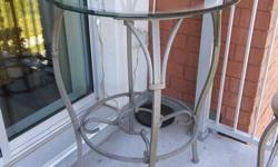 Frame and chairs is made of metal Top is plate gass 32 inches in diamater height of table 39 inches excellent condition.