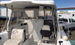 This boat was stored in a barn for 5 years and had only 25 hours on it when I bought it in 2010. It now has 340 hours and is in excellent condition. It comes with a 5 liter MPI Mercruiser, Alpha Leg, Counter rotating Props, 9.9 h.p. Merc kicker with