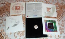 comes with 1.96 cents in stamps and a dove quarter. LOL. the case is slightly scratched and dented.pretty cool hologram stamp changes from 1999 to 2000.