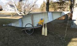 16 ft fiberglass canoe with paddles and new lifejacket also two wheel cart for moving
