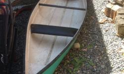 13ft fiberglass canoe. Older but in good condition.