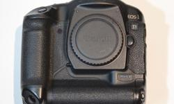This camera has some wear. There are scuffs on the control dial on the back, various paint scuffs on the body, and some paint wear near the shutter button which can all be seen in the photos. Shutter count is under 90,000. Comes with new battery