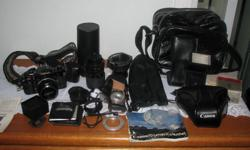 CANON A-1 AND LENS AND MUCH MORE!   HAVE HAD THIS CAMER FROM NEW. THERE ARE A LOT OF EXTRAS AS YOU CAN SEE IN THE PIX. I AM TAKING OFFERS ON IT AS  ONE  ITEM YOU GET ALL OF IT ! PH OR EMAIL 250-490-2820