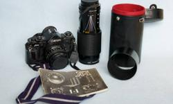 ? Canon A1 Camera with FD 50 mm 1:1.8 Lens 58 mm Vivitar Filter ? Canon Power Winder ? Fast Action Case and Instruction Booklet ? Tokina 35-105 mm 1:3.5-4.5 Lens with 58 mm Vivitar Skylicht Filter ? Canon FD 70-210 mm 1:4 Zoom Lens with Hoya 58 mm