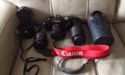 In excellent condition. Includes 52 mm fixed lens, 55-70 mm Macro lens and 70-210 mm telephoto macro lens.