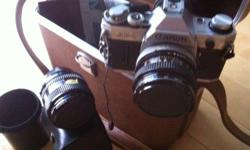 Vintage AE-1. With 28mm wide angle lens and accessories. Functions perfect. 55$ OBO.