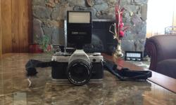 Lightly used Canon AE-1 Film Camera with Canon 188A flash, lens and original strap. $200 OBO